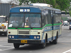 ac-white-blue-bus